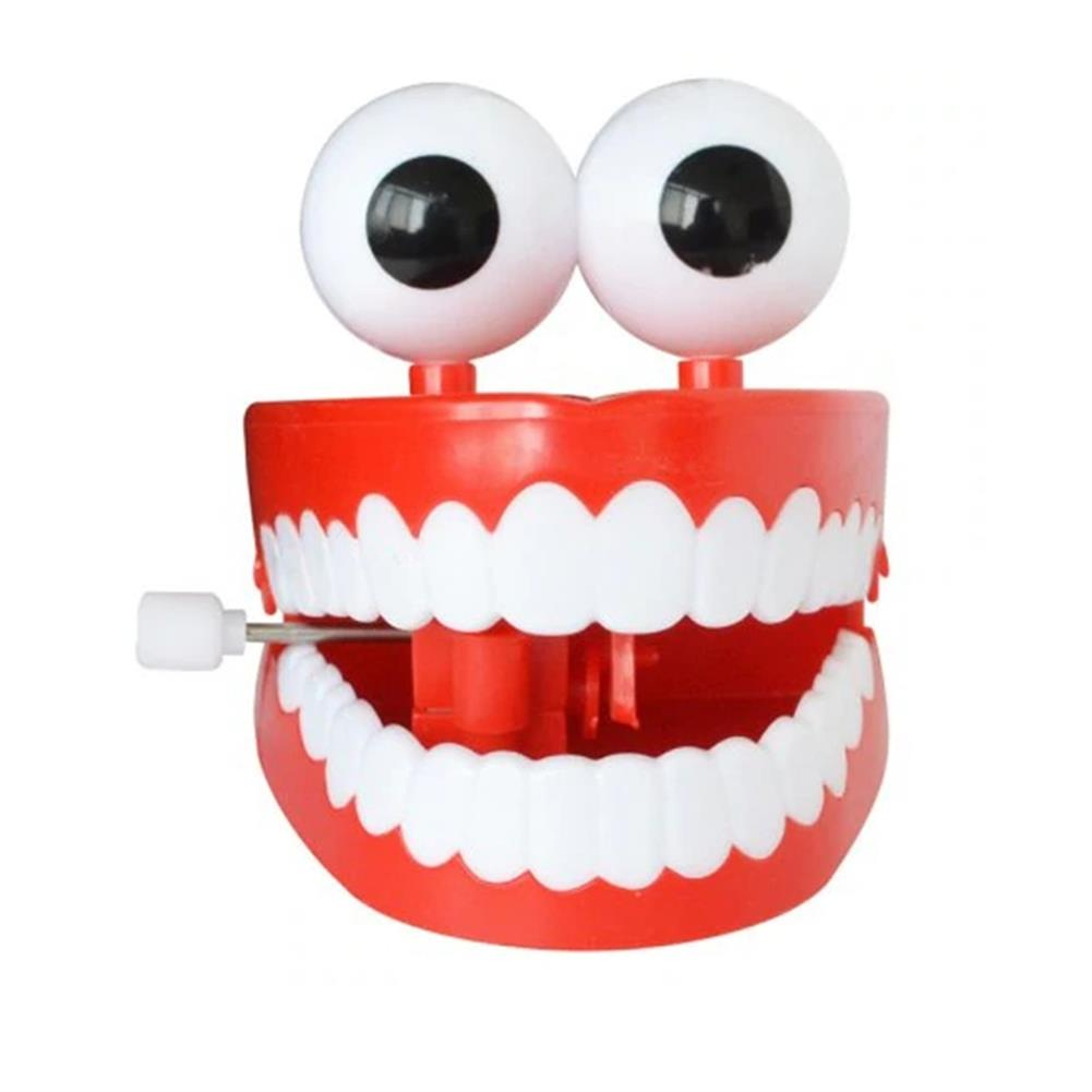 wind-up-tin-toys 1Pc Clockwork Jumping Teeth Red Wind Up Funny Mouth Tooth with Eyes Flashing Novelties Trick Toys HOB1441349